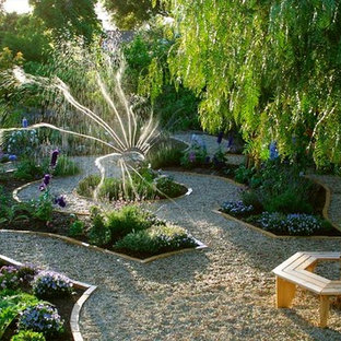 Photo of a large transitional backyard partial sun formal garden in Santa Barbara with gravel and a vegetable garden.