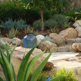 Photo of a mediterranean hillside stone landscaping in Santa Barbara.