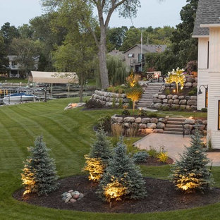Inspiration for a large traditional backyard stone garden path in Minneapolis.