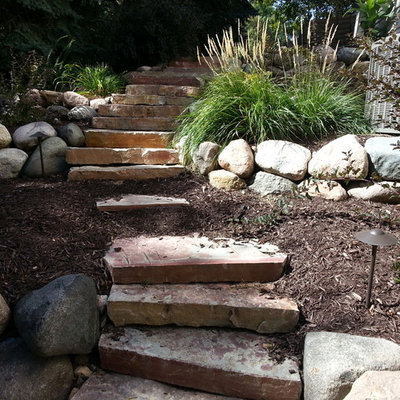 Photo of a traditional backyard landscaping in Minneapolis.