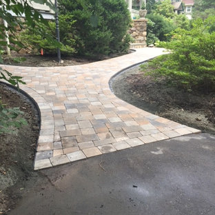 This is an example of a mid-sized traditional full sun front yard concrete paver garden path in New York.