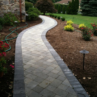 Inspiration for a mid-sized rustic front yard brick garden path in Wilmington.