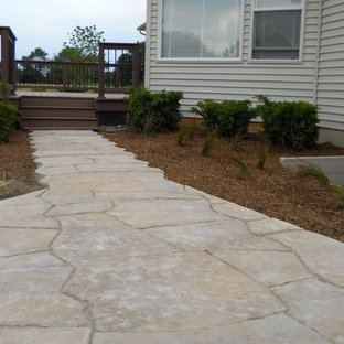 Photo of a large traditional partial sun backyard stone garden path in Detroit.