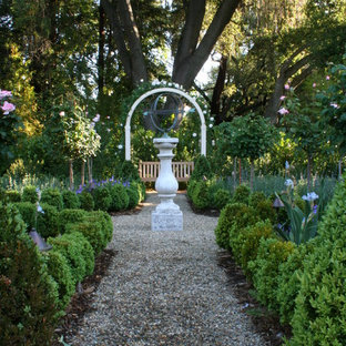 This is an example of a traditional backyard gravel formal garden in San Francisco.