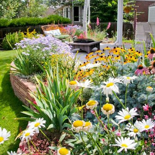 This is an example of a small traditional partial sun backyard concrete landscaping in Denver for summer.