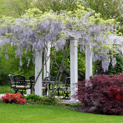 Inspiration for a mid-sized traditional full sun backyard stone landscaping in Boston for spring.