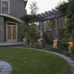 Design ideas for a mid-sized contemporary partial sun backyard stone lawn edging in Detroit.