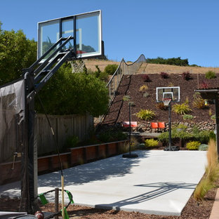 This is an example of a large mediterranean full sun backyard concrete paver landscaping in San Francisco.