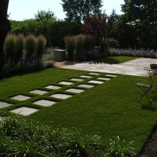 This is an example of a contemporary backyard stone landscaping in Chicago.