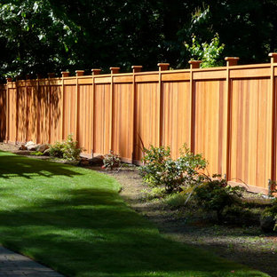 This is an example of a large contemporary backyard formal garden in Portland.