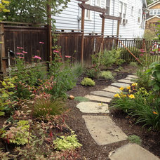 Traditional Landscape by Greener Living Solutions, Inc
