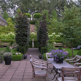 This is an example of a traditional garden in Other with with privacy feature.