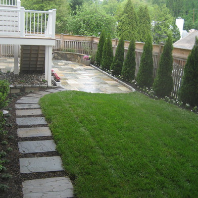 Photo of a mid-sized traditional partial sun backyard stone garden path in DC Metro for spring.
