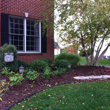 Traditional Landscape by Hively Landscaping Inc.