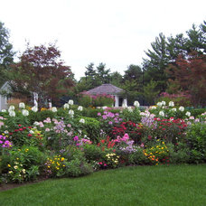 Traditional Landscape by NatureWorks Landscape Services, Inc.