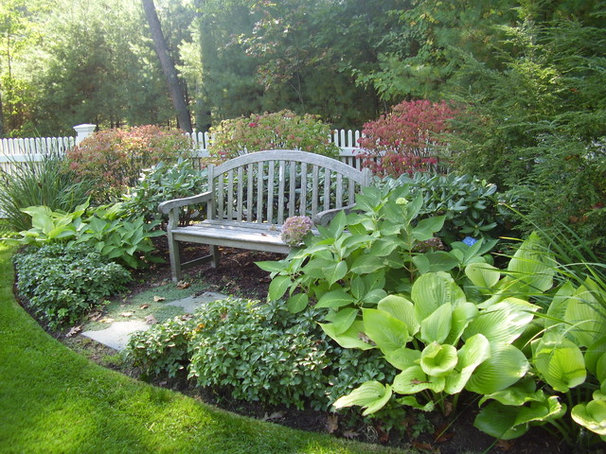 Traditional Landscape by NatureWorks Landscape Services, Inc.