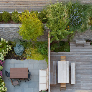 Inspiration for a mid-sized modern partial sun backyard formal garden in New York with decking.