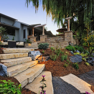This is an example of a large rustic hillside stone landscaping in Milwaukee.
