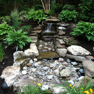 Inspiration for a mid-sized asian partial sun backyard stone pond in New York for spring.