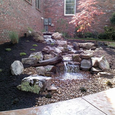 Traditional Landscape by Carter's Nursery, Pond & Patio