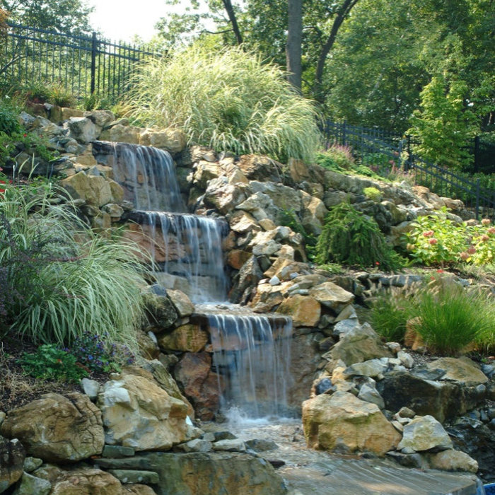 Fish Ponds & Waterfalls Designed and Installed By Designscapes Landscaping LI