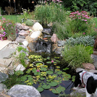 Inspiration for a traditional backyard water fountain landscape in Denver.