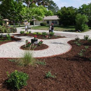 Inspiration for a full sun front yard gravel garden path in Jacksonville.