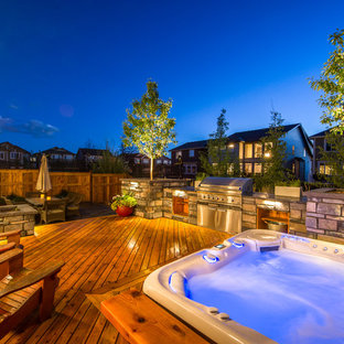 Inspiration for a mid-sized modern backyard formal garden in Calgary with decking.