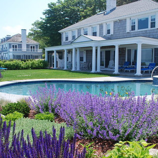 Design ideas for a traditional full sun backyard landscaping in Boston.