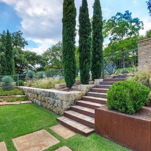 Photo of a large modern full sun front yard stone landscaping in Austin for spring.