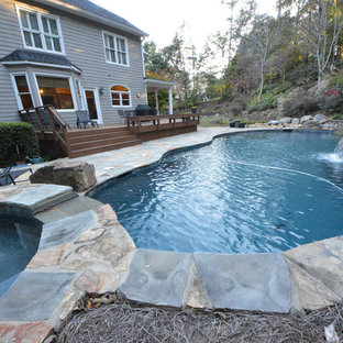 Photo of a modern full sun backyard stone outdoor sport court in Atlanta for summer.