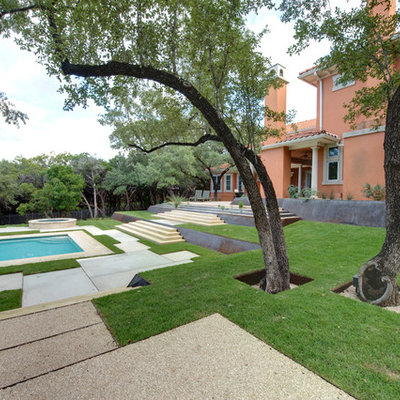 Photo of a contemporary retaining wall landscape in Austin.