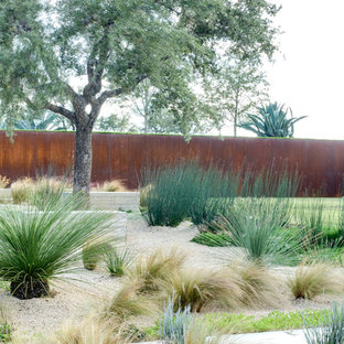 This is an example of an industrial xeriscape in Austin with gravel.