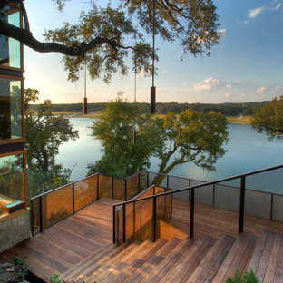 This is an example of a contemporary sloped garden in Austin with decking.