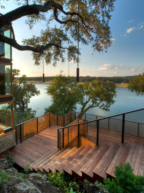 This Is An Example Of A Contemporary Hillside Landscape In Austin With  Decking.
