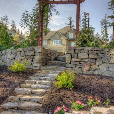 Inspiration for a traditional hillside stone landscaping in Portland.
