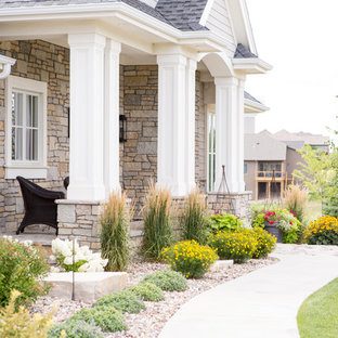 Inspiration for a mid-sized contemporary drought-tolerant and partial sun front yard stone landscaping in Other for summer.