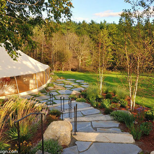Inspiration for a large traditional partial sun side yard stone landscaping in Boston for spring.