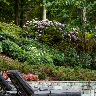 Inspiration for a huge traditional backyard retaining wall landscape in DC Metro.