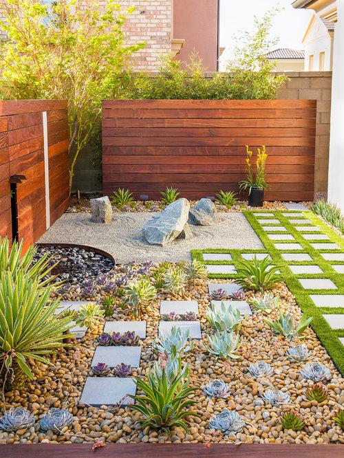 Example Of A Trendy Backyard Concrete Paver Patio Design In Orange County