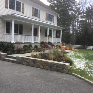 Inspiration for a mid-sized traditional full sun front yard stone driveway in New York for winter.