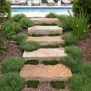 This is an example of a traditional backyard stone landscaping in Little Rock.