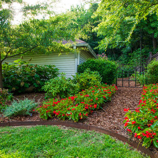 Inspiration for a traditional backyard mulch landscaping in Little Rock.