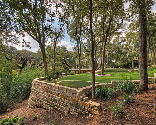 this is an example of a large traditional shaded front yard landscape in austin for spring