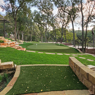 Design ideas for a large traditional shade front yard stone landscaping in Austin for spring.