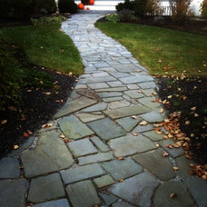 Traditional Landscape by New England Landscapes, Inc.