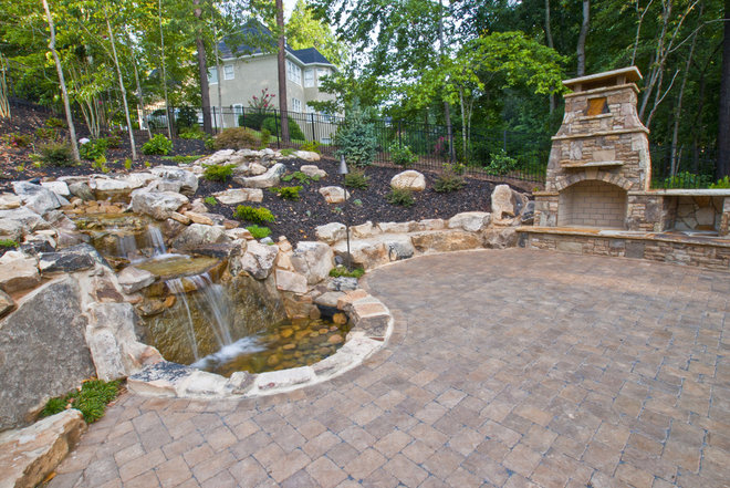 Traditional Landscape by Property Masters