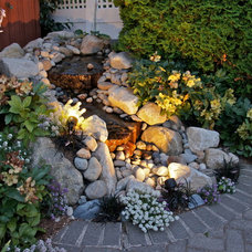 Eclectic Landscape by Urban Oasis Design & Construction LLC