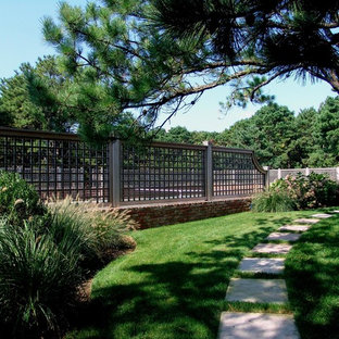 Design ideas for a large traditional partial sun backyard concrete paver landscaping in New York.