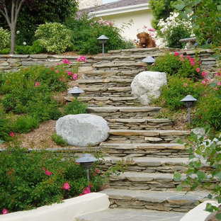 Photo of a traditional hillside retaining wall landscape in San Diego.